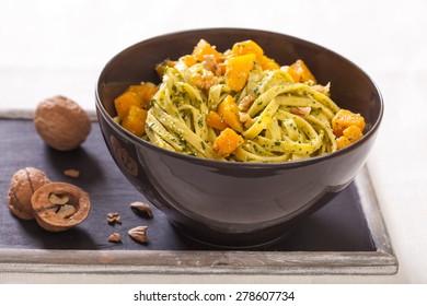 Tagliatelle noodles with pumpkin, walnuts and basil pesto