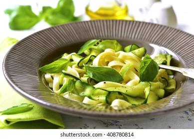 Tagliatelle with zuc?hini in a plate in light background.