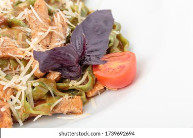 Tagliatelle spinach pasta with beaf and cheese. This is a fragment of a dish. There is a place for text. Close-up.