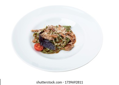 Tagliatelle spinach pasta with beaf and cheese. Isolated in a white background. Close-up.