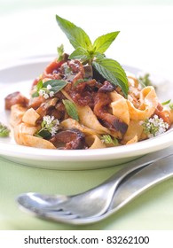Tagliatelle with zucchini and tomato sauce and mint. Selective focus