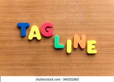 tagline  colorful word on the wooden background