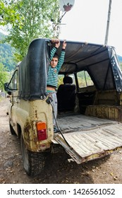 Tago, Adjara region, Georgia - September 22, 2018: Local boy on old car in the mountains of the Caucasus. The village is located above Khulo. Where the cableway goes.