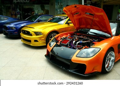 TAGUIG CITY, PHILIPPINES - JUNE 27, 2015: Expensive and customized luxury and race cars are displayed in a car show in Bonifacio Global City.