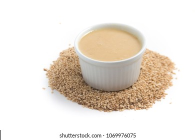 Tahini in a bowl isolated on white background