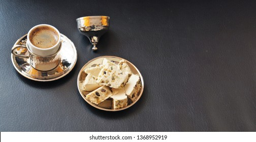 tahini halva and Turkish coffee in a traditional metal cup with a lid on a black background
