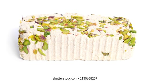 Tahini-based halva with pistachios. Isolated on white background.