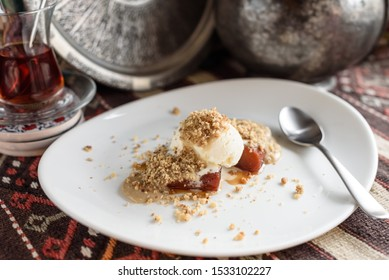 Tahinli Kabak Tatlisi, Sweet Pumpkin with Sesame Paste Tahini Topped with Ice Cream and Walnut. Turkish Dessert.