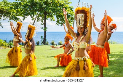 TAHITI, FRENCH POLYNESIA - JULY 25, 2017 : Polynesian women perform traditional dance in Tahiti. Polynesia. Polynesian dances are major tourist attraction of luxury resorts of French Polynesia.