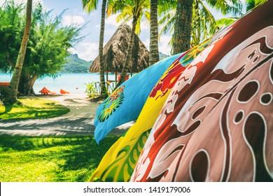 Tahiti vacation background saron pareo tahitian skirts flowing in the wind at beach resort souvenir shop of hotel. Sarong wrap skirt, Tahiti, French Polynesia. Handmade tourism souvenir.