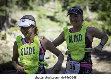 Tahoe City, CA, USA - June 24, 2017: Amy Dixon (#16) and Christy Fritts became the first female blind athlete and guide team to race an XTERRA.