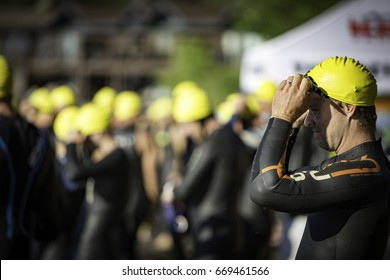 Tahoe City, CA, USA - June 24, 2017: Triathletes toe the starting line of XTERRA Tahoe City.