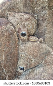 """Tahoe City, California - 2019: Mother Grizzly Bear, and her two cubs, with fur made of 200,000 American and Canadian pennies. Named """"Ursa Mater"""" but frequently called """"Penny Bear"""" in Heritage Plaza."""
