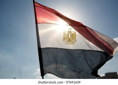 Tahrir square, Cairo, Egypt, January 2011, The Egyptian flag waving among the blue sky