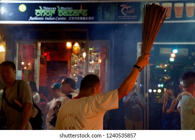 Tai Hang, Causeway Bay, Hong Kong - 25 September 2018: Dancer preparing incense sticks to set up the fire dragon before start the dance.
