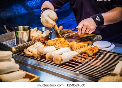Taichung, Taiwan - April 26, 2018: A food stalls selling grilled king oyster mushrooms on sticks at the Fengjia night market.