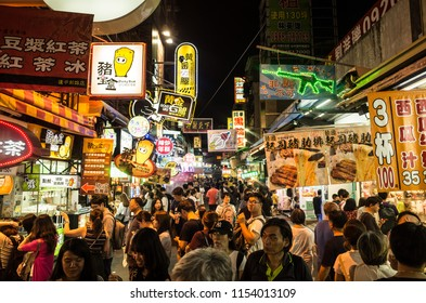TAICHUNG, TAIWAN - August 10, 2018. Fengjia night market the largest night market in Taiwan,  a street in night market with a lot of food and drinks.
