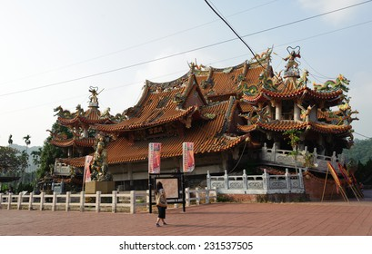 Taichung, Taiwan - August 14, 2014: Collapsed Wuchang Temple in JiJi Nantou Taiwan during the 921 Earthquake. The temple remains from the earthquake were not demolished and new one is built.