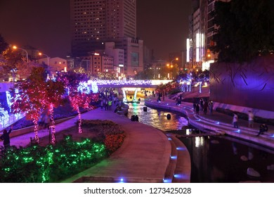 TAICHUNG, TAIWAN - DECEMBER 2, 2018: People visit Liuchuan Riverside Walk decorated for Christmas in Taichung, the second largest city in Taiwan (2.8 million inhabitants).