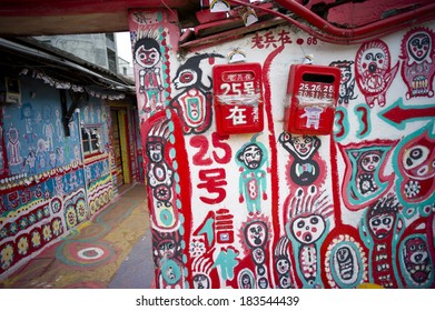 TAICHUNG, TAIWAN - FEB 16: Colorful graffiti painted in the whole Rainbow village on Feburary 16, 2014. It becomes a famous sightseeing spot in Taiwan. It delivers joyful message.