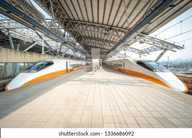 Taichung, Taiwan -  Feb 26, 2019: Two Taiwan High Speed Rail trains are stopping at the station.