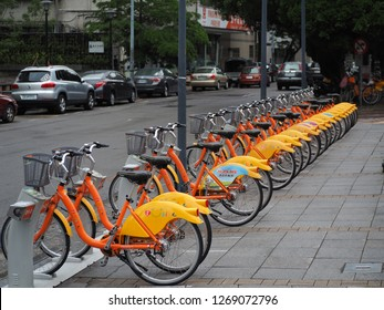 TAICHUNG, TAIWAN - MAY 16, 2017: A row of U-bike, a popular network of rental bicycle, parking on the footpaht, Tourists can lend it from using mobile phone application to ride along the town.