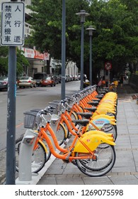 TAICHUNG, TAIWAN - MAY 16, 2017: A row of Ubike near subway, a popular network of rental bicycle parking on the footpaht, Tourists can lend it from using mobilephone application to ride along the town
