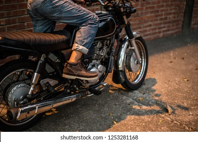 Taichung, Taiwan - Nov 5, 2018. A motorcycle parking in the alley with brick wall and kick to start motorcycle