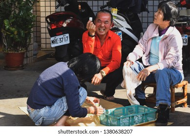 Taichung,Taichung City,Taiwan-02/17/2018:The new Taiwan chinese new year culture is having something fun with gamble with relatives.This photo is relatives washing the traditional chess Mahjong.