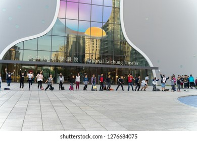 Taichung,Taiwan - 20 DECEMBER 2018;children  jumping at front of National Taichung Theater beautiful architecture