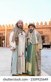 Taif, Saudi Arabia – August 12th 2019: Arabic man wears traditional old clothes and performs ancient story in Souq Okaz Festival the Arabian traditional cultural event in Taif, Saudi Arabia.