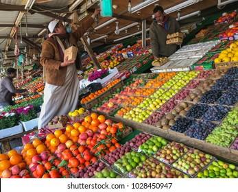 TAIF, SAUDI ARABIA-JANUARY 22, 2018 : Unidentified Arab men sells fresh fruits at a fruit market in Taif, Makkah, Saudi Arabia..