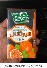 Taif, Saudi - November 27, 2018: Hand holding Al Rabie Orange Drink 250 ml. Al Rabie drinks manufactured by Al Rabie Saudi Foods Co. Ltd.