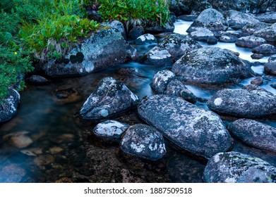 "Taiga. Siberia. Ergaki. Mountain stream flowing from the lake ""Svetloe."" - Shutterstock ID 1887509518"
