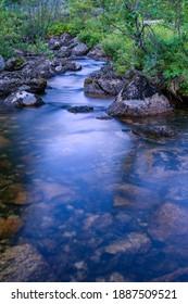 "Taiga. Siberia. Ergaki. Mountain stream flowing from the lake ""Svetloe."" - Shutterstock ID 1887509521"
