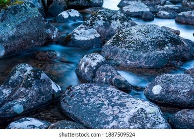 "Taiga. Siberia. Ergaki. Mountain stream flowing from the lake ""Svetloe."" - Shutterstock ID 1887509524"