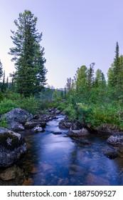 "Taiga. Siberia. Ergaki. Mountain stream flowing from the lake ""Svetloe."" - Shutterstock ID 1887509527"
