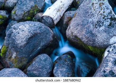 "Taiga. Siberia. Ergaki. Mountain stream flowing from the lake ""Svetloe."" - Shutterstock ID 1887680962"