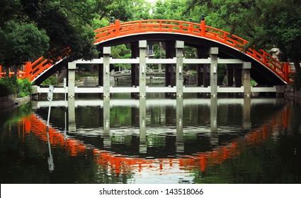 Taiko Bashi (Drum Bridge) and reflection at Sumiyoshi Grand Shrine in Osaka, Japan