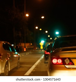tail light of back car on night urban street road