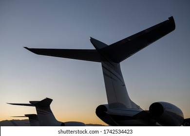 Tail section of Gulfstream Jets at sunset