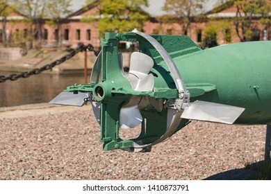The tail of the torpedo with rudders and propellers mounted on the pier as an exhibit of a museum of weapons.
