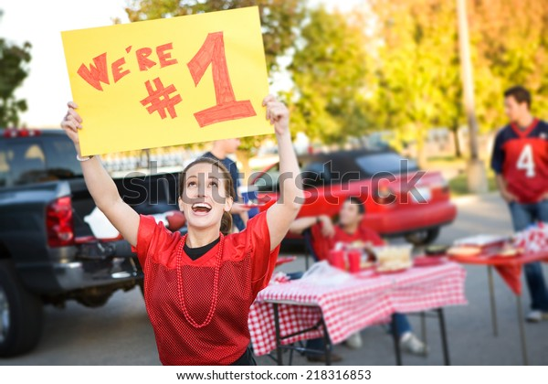 Tailgate: Pretty Woman Holds Up #1 Team Sign At Party