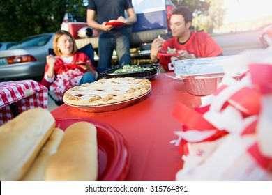 Tailgating: Focus On Apple Pie On Table Of Tailgate Party Food