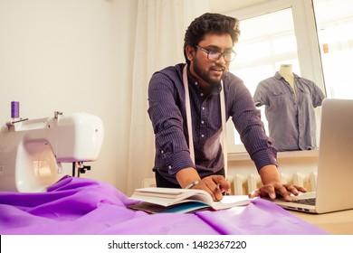 tailor-asian-man-designer-sewing-260nw-1482367220.jpg