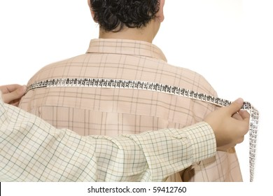 tailor measures the customer back