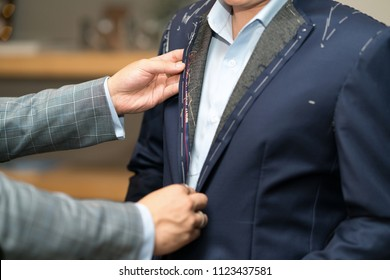 Tailor measures a man