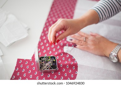 Tailor measuring textile material. young woman seamstress making pattern on fabric with tailors chalk. Girl working with a sewing pattern. Hobby sewing as a small business concept.