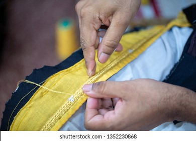A tailor preparing the final touches of a bisht, a men's clothing in Qatar