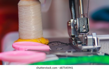 Tailor scissors, measuring tape and a sewing machine
